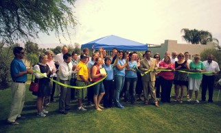 Pearl Verre, second from right, celebrates with GRID Alternatives and community partners at the Desert Rose solar ribbon cutting.