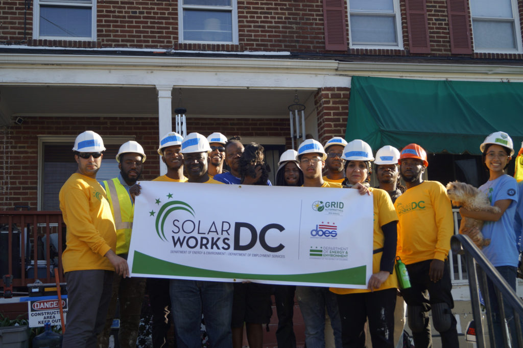 SolarWorks DC cohort celebrates successful install with homeowner